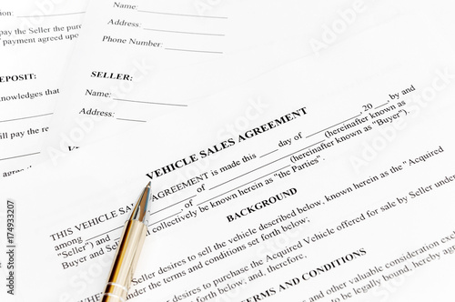 Vehicle sales agreement with pen - Buy this stock photo and explore