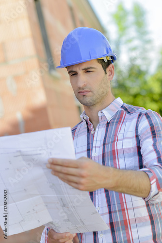 architect reading blueprints - Buy this stock photo and explore