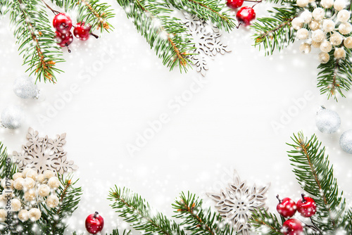 Christmas background with xmas tree, berries on white wooden