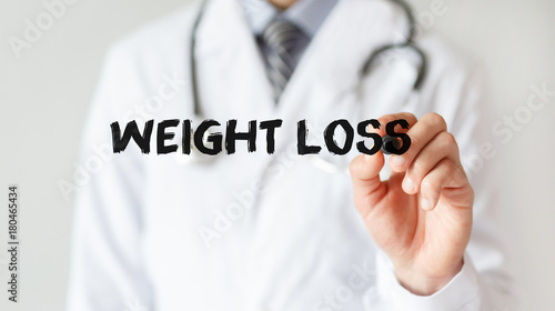 Doctor writing word Weight Loss with marker, Medical concept - Buy