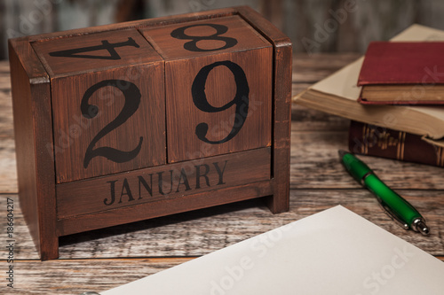 Perpetual Calendar in desk scene with blank diary page, January 29th - blank diary page