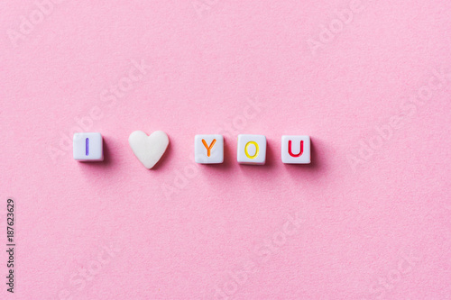 Phrase I Love You Made from Letter Cubes and Single Heart Shape