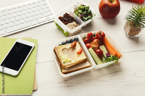 Healthy meals in lunch boxes at office working table - Buy this