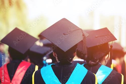 backside female graduation hats during commencement success