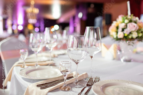 Round table at a luxury wedding reception Beautiful flowers on the