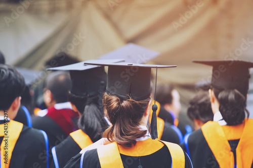 shot of graduation hats during commencement success graduates of the