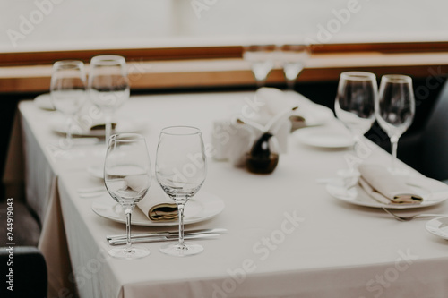 Decorated served table with cutlery and glasses for wedding