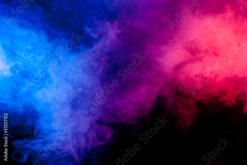 Red and blue smoke on black background - Buy this stock photo and