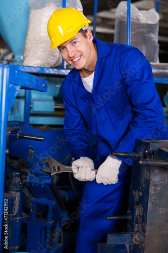 industrial mechanic repairing machine - Buy this stock photo and