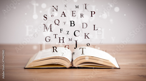 Opened book with flying letters - Buy this stock photo and explore - opened book