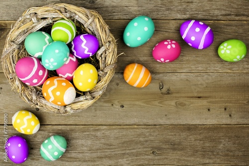 Easter egg border with nest over old wood background - Buy this