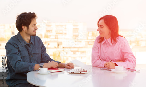 Informal Business Meeting at Roof Top Cafe - Buy this stock photo