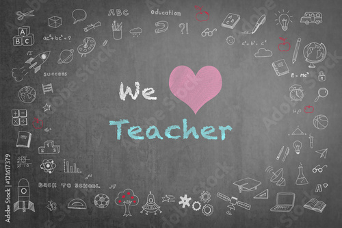 We love teacher message on black chalkboard with doodle free hand