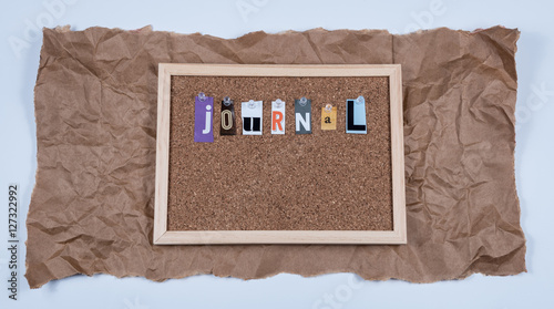 The Word Journal on Cork Board - Buy this stock photo and explore