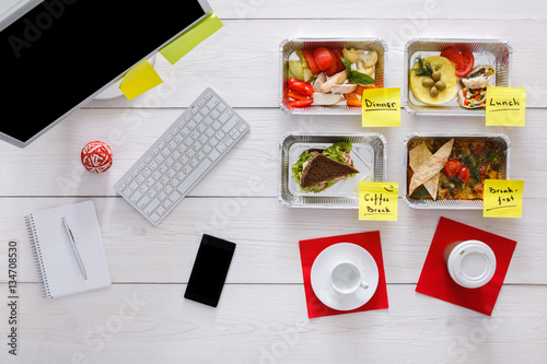 Healthy daily meals in office, top view at wood - Buy this stock