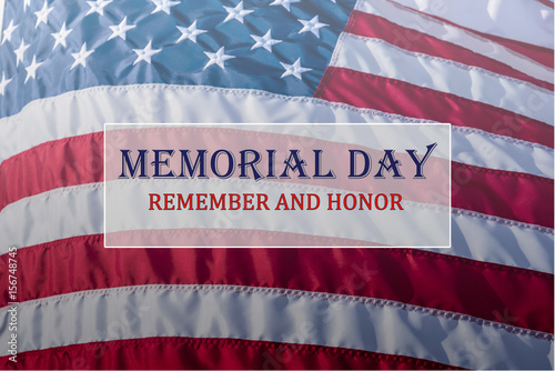 Text Memorial Day and Honor on flowing American flag background