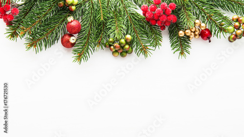 Christmas background with xmas tree and red berries on white wooden