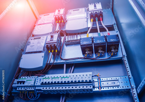 Wires and switches in electric box Electrical panel with fuses and