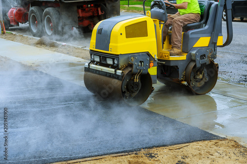 Asphalting construction works with commercial repair equipment road - asphalting machine