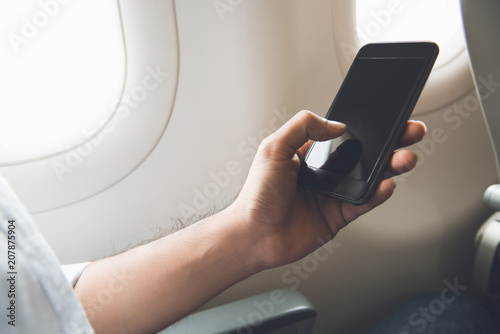 Male passenger turning off mobile phone on the airplane - Buy this - turning off phone