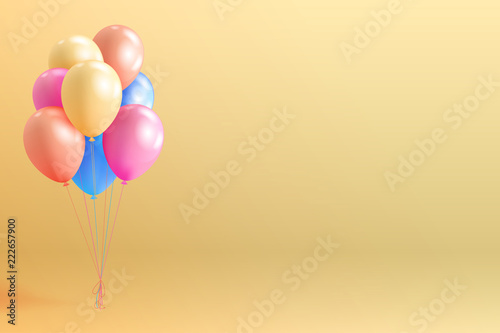 Set of realistic glossy helium balloons floating on yellow