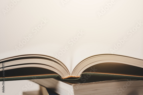 a stack of books with an open book, pages Reading books, studying