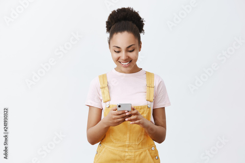 Cute carefree girl making schedule for tomorrow with new app