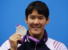 South Korea's Park Tae-hwan poses with his silver medal for the men's 200m freestyle final at the London 2012 Olympic Games at the Aquatics Centre