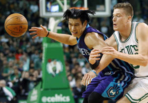 Charlotte Hornets' Jeremy Lin losses the ball while being defended by Boston Celtics' Jonas Jerebko during the second half of the Charlotte