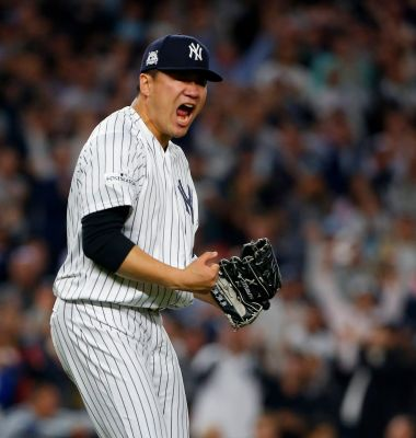 Masahiro Tanaka of the Yankees reacts after the