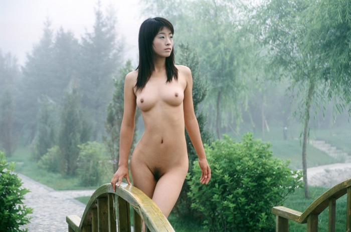Cute and seductive Asian babe gladly demonstrates her juicy boobies