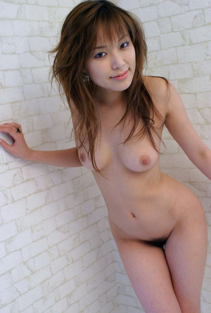 Asian chick with great body posing at nature