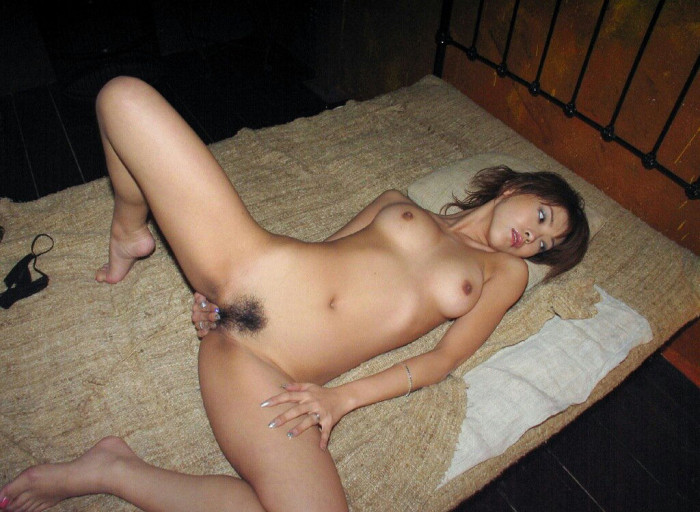 Very lovely asian with very small tits on white sofa