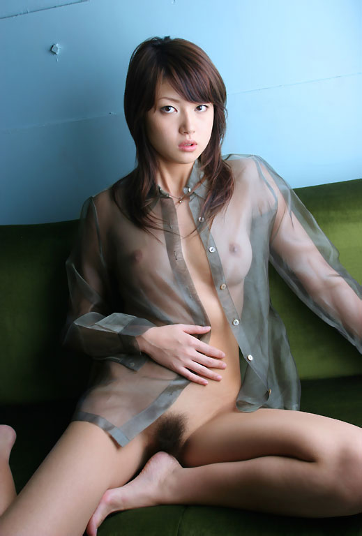Attractive Asian babe has already put off her white blouse, so that you can see her elastic boobs