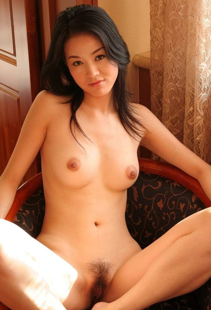 Attractive and definitely horny Japanese babe has got a perfect body, which she doesn't mind showing off