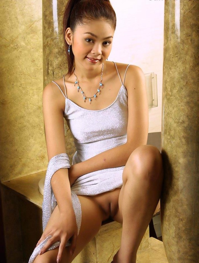 Cute Asian girl in sexy lingerie at home