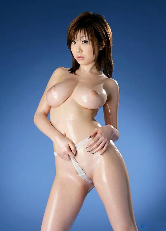 Korean housewife posing naked in the kitchen