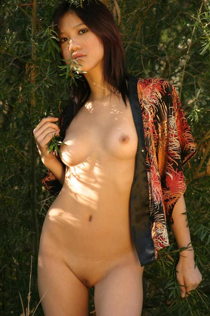 Sweet asian chick washes her shaved pussy in shower outdoors