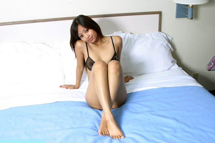 Sexiest asian with sporty body and shaved pussy widely spreads her legs