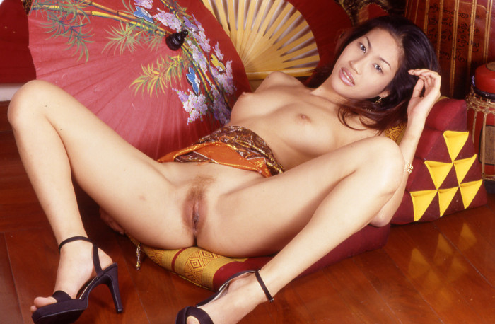 Petite thai girl with purple vibrator in her pussy