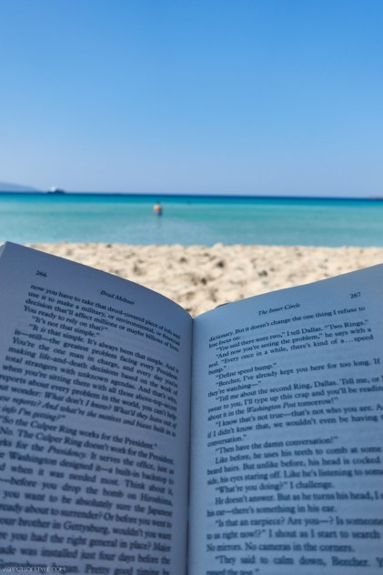 reading a book in Simos beach Elafonisos, Greece