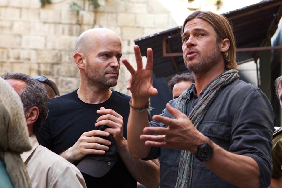 O diretor Marc Foster e Brad Pitt