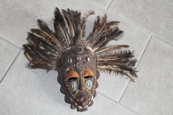 African Mask Decorated With Shells And Feathers Catawiki