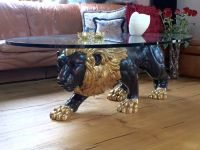 Oval coffee table with carved wooden lion sculpture from ...