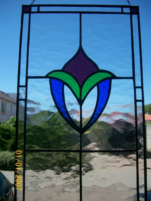 Two stained glass windows -rectangular secondary frame in blue