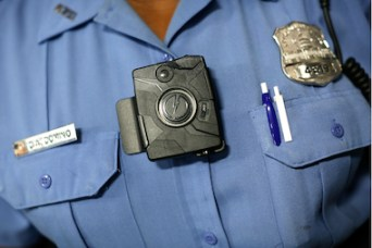 "Washington D.C. Metropolitan Police Officer Debra Domino wears one of the new ""body-worn cameras"" that the city's officers will begin using."