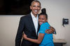 This Young Volunteer Stole A Hug From Barack Obama