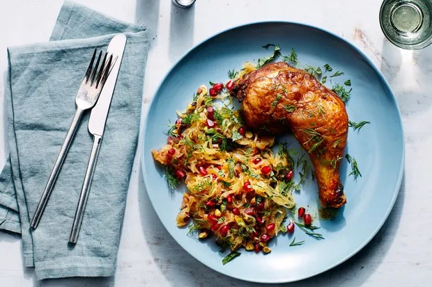 Persian Chicken With Spaghetti Squash, Pomegranate, and Pistachios / Photo by Chelsea Kyle, Prop Styling by Alex Brannian, Food Styling by Anna Stockwell