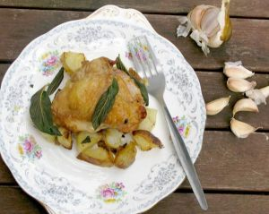 Crispy garlic chicken thighs with diced roast potatoes and crispy sage