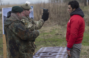 A demonstration of joint working between International Security Assistance Force and Afghan National Security Forces troops as a potential new recruit to the Afghan police is photographed and finger printed before his training programme starts [Picture: A